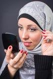 Muslim woman pooling eyebrows. Beautiful muslim woman pooling eyebrows Stock Photos