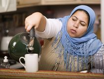 Muslim woman pouring tea Royalty Free Stock Images