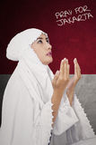 Muslim woman pray for Jakarta Royalty Free Stock Images