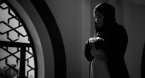 Muslim woman pray in mosque. Young muslim woman pray in mosque Stock Photos
