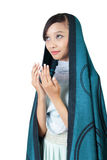 Muslim woman pray. Portrait of young Asian muslim  woman praying, isolated on white background Stock Photography