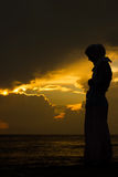 Muslim woman praying. Young muslim woman praying at sunset Royalty Free Stock Photography