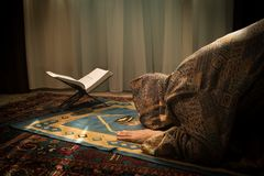 Muslim woman praying for Allah muslim god at room near window. Hands of muslim woman on the carpet praying in traditional wearing. Clothes, Woman in Hijab Royalty Free Stock Photo