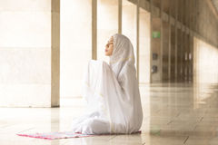 Muslim woman praying for Allah, muslim god. Muslim woman wearing prayer veil, praying for Allah, muslim god Royalty Free Stock Photos
