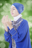 Muslim woman praying with bokeh background Stock Photos