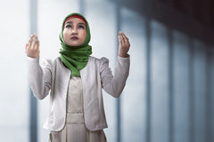 Muslim woman praying. Image of muslim woman praying over mosque background Royalty Free Stock Images