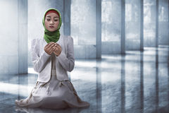 Muslim woman praying. Image of muslim woman praying over mosque background Royalty Free Stock Photos