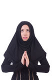 Muslim woman praying. Isolated on white Stock Photography