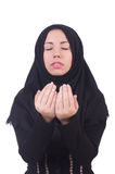 Muslim woman praying. Isolated on white Stock Photo