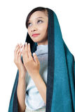 Muslim woman praying, isolated on white. Young Asian woman in veil looking up and praying with open hands gesture, isolated on white background Royalty Free Stock Photography