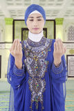 Muslim woman praying in mosque Royalty Free Stock Images