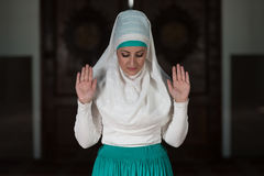 Muslim Woman Is Praying In The Mosque Stock Images