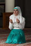 Muslim Woman Is Praying In The Mosque Stock Photography