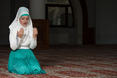 Muslim Woman Is Praying In The Mosque Stock Photos
