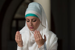 Muslim Woman Is Praying In The Mosque Stock Photo