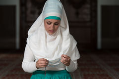 Muslim Woman Praying In Mosque Royalty Free Stock Photography