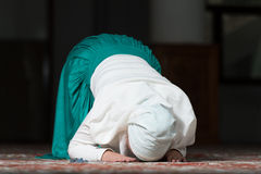 Muslim Woman Praying In Mosque Royalty Free Stock Photo
