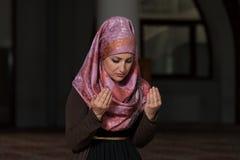 Muslim Woman Praying In Mosque Stock Photos