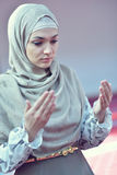 Muslim woman praying in mosque Royalty Free Stock Photo