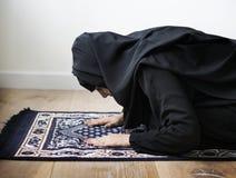 Muslim woman praying in Sujud posture Stock Image