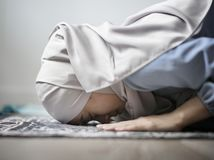 Muslim woman praying in Sujud posture Stock Photos