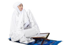 Muslim woman praying on traditional way Stock Image