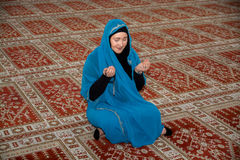 Muslim woman praying Royalty Free Stock Photo