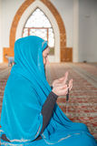 Muslim woman praying Royalty Free Stock Images