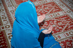 Muslim woman praying Stock Photography