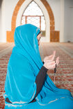 Muslim woman praying Stock Photos