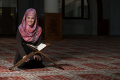 Muslim Woman Is Reading The Koran Stock Photos