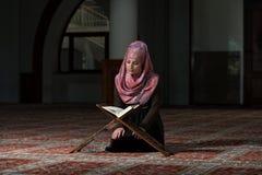 Muslim Woman Reading The Koran. Muslim Woman Reading Holy Islamic Book Koran Royalty Free Stock Photo