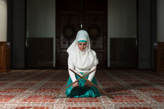Muslim Woman Reading The Koran Royalty Free Stock Photos