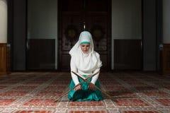 Muslim Woman Reading The Koran Royalty Free Stock Photos