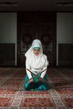 Muslim Woman Is Reading The Koran Royalty Free Stock Photos