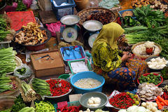 Muslim woman selling fresh vegetables at market in Malaysia. Muslim woman selling fresh vegetables at market in Kota Bharu Malaysia Royalty Free Stock Image