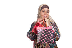 Muslim woman with shopping bags Stock Images