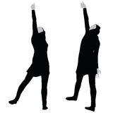 Muslim woman silhouette in victorious pose Stock Images