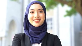 Muslim woman smiling. Beautiful muslim business woman smiling stock video