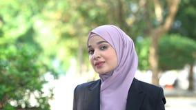 Muslim woman smiling. Beautiful Muslim business woman smiling stock footage