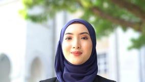 Muslim woman smiling. Beautiful Muslim business woman smiling stock video footage