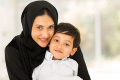 Muslim woman son. Portrait of pretty muslim women with her son royalty free stock image