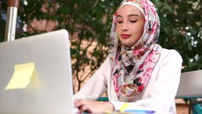 Muslim woman spending leisure with laptop stock footage