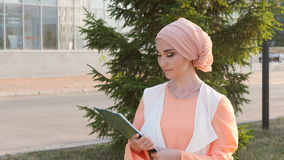 Muslim woman standing with document paper stock video footage
