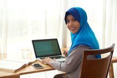 Muslim woman studying royalty free stock photography