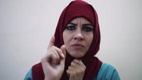 Muslim woman swears. Girl arabic stock footage
