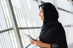 Muslim woman tablet computer. Side view of smiling muslim woman with tablet computer Stock Images