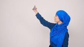 Muslim woman taking selfie. Arabian muslim woman taking selfie stock video