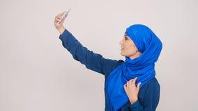 Muslim woman taking selfie. Arabian muslim woman taking selfie stock video footage