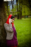 Muslim woman talking on the phone and using technology. Muslim woman is using smart phone Stock Photos